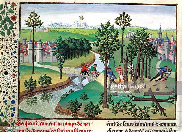 Building a road 15th century Woodmen fell trees with axes while paviors lay the surface of an already cleared road From the Chronicles of Hainaut