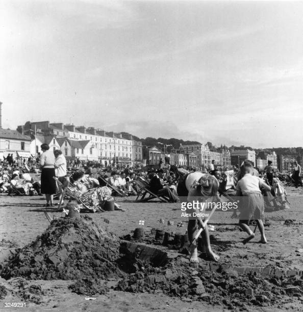 Building a sand castle on the Isle of Man Original Publication Picture Post 8351 BEACH ON THE ISLE OF MAN unpub