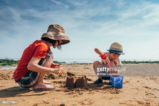 building a sandcastle - peter lourenco stock pictures, royalty-free photos & images