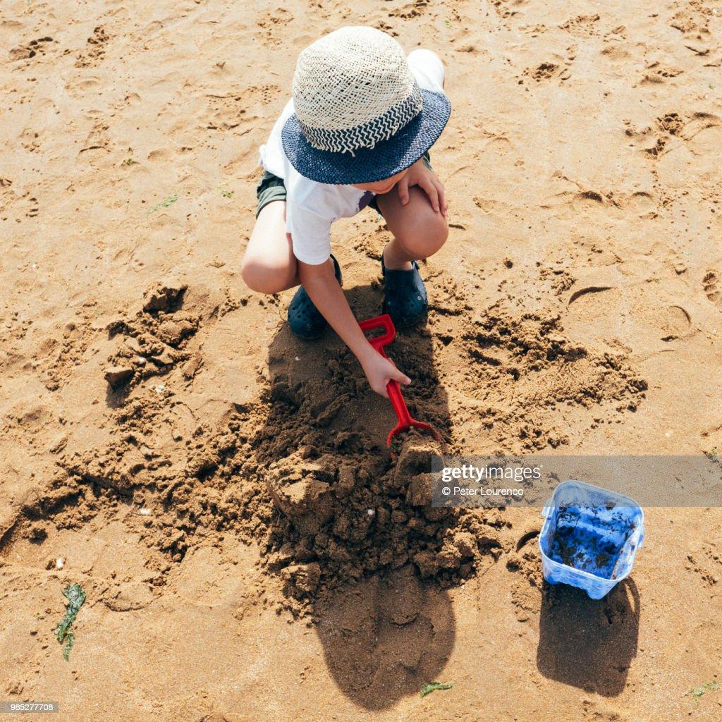 Building a sandcastle : Stock Photo