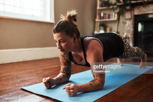 building a stronger core - plank position stock pictures, royalty-free photos & images