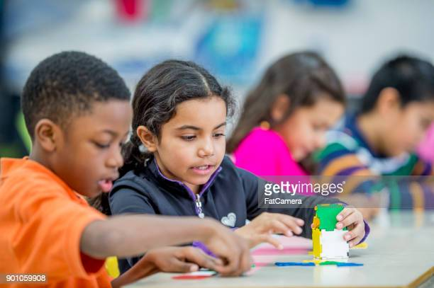 building a tower - elementary student stock pictures, royalty-free photos & images
