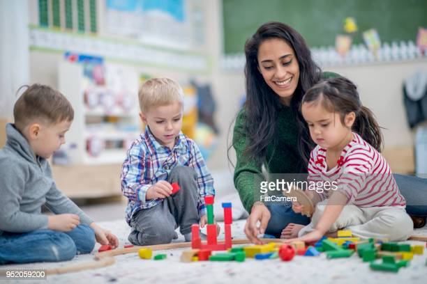 building a tower - preschool age stock pictures, royalty-free photos & images