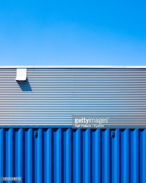 building against blue sky - corrugated iron stock photos and pictures