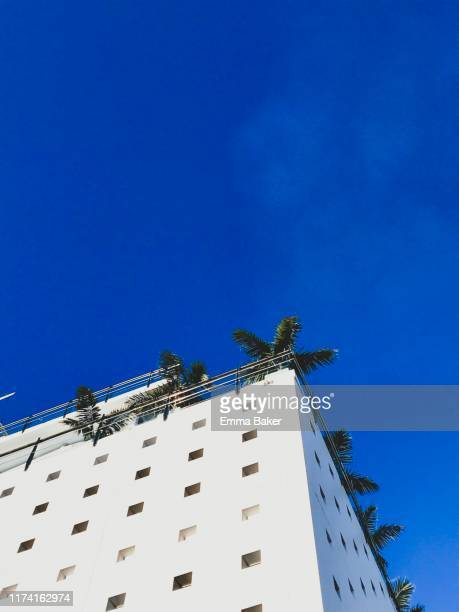 building against blue sky - emma baker stock pictures, royalty-free photos & images