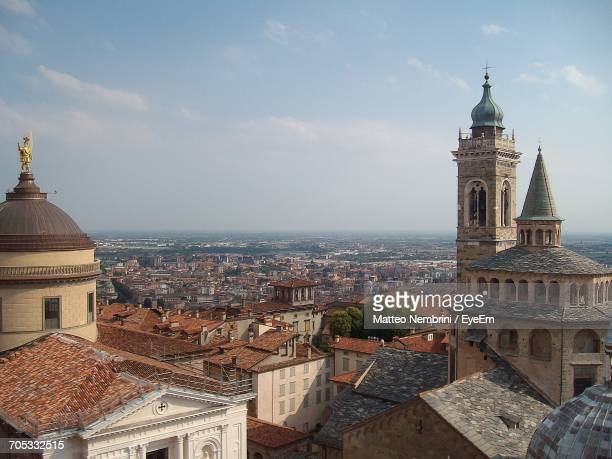 building against cloudy sky - bergamo stock pictures, royalty-free photos & images