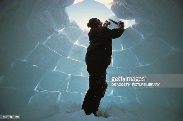 Building an igloo Baffin Island Canada