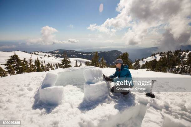 building an igloo on seymour mountain, vancouver, british columbia, canada. - igloo stock pictures, royalty-free photos & images