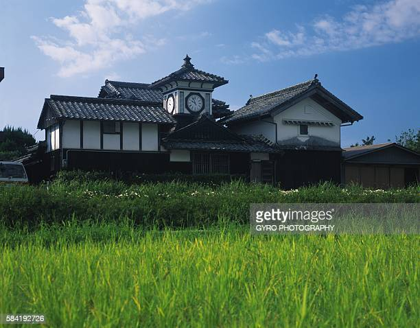 Building and a Clock Tower With a Field in the Foreground. Kochi Prefecture, Japan