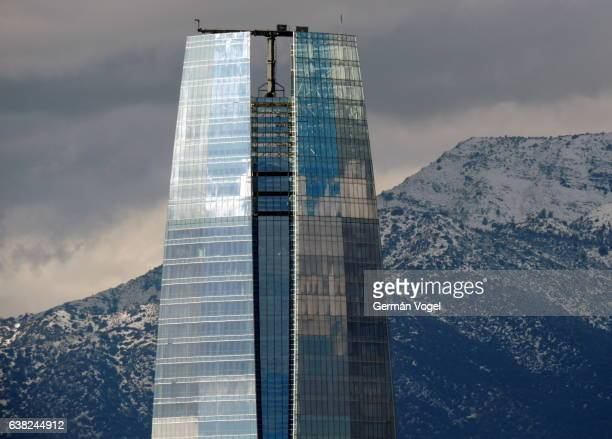 Building and mountain competition - Tallest building in South America, above snowed Andes mountain peaks - Santiago, Chile