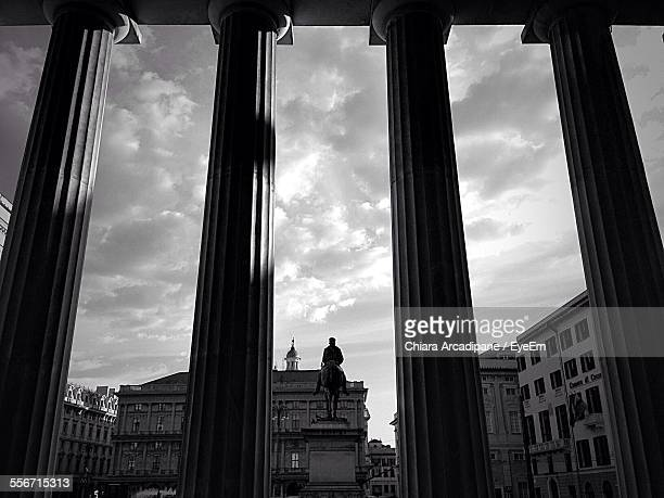 building and statue seen from teatro carlo felice against cloudy sky - オペラ座 ストックフォトと画像