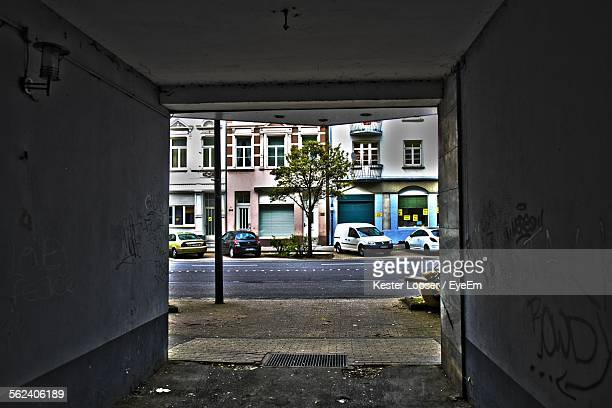 Building And Street Seen Through Space Of Empty Garage