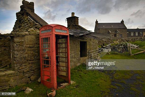 Building and telephone box on the Island of Foula on September 29 2016 in Foula Scotland Foula is the remotest inhabited island in Great Britain with...