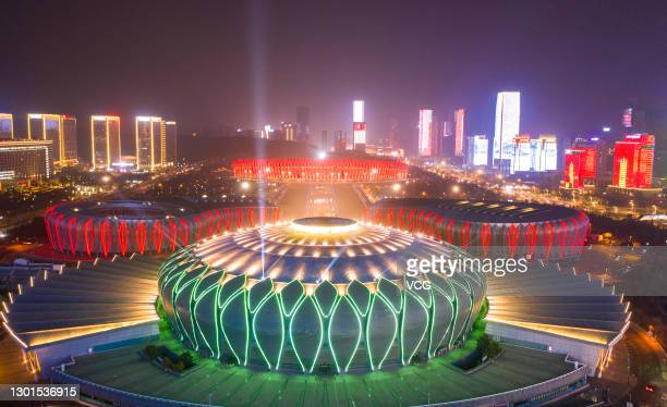 Building are illuminated to mark the upcoming Chinese New Year, the Year of the Ox, at the Jinan Olympic Sports Center on February 10, 2021 in Jinan,...