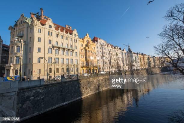building at the waterfront, vltava river, prague, czech republic - vsojoy stockfoto's en -beelden