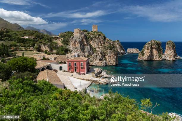 building at waterfront - sicily stock pictures, royalty-free photos & images