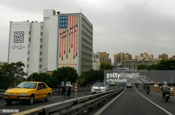 A building bearing an antiUS slogan is seen in the Iranian capital Tehran on May 8 2018 US President Donald Trump is due to make his decision on...