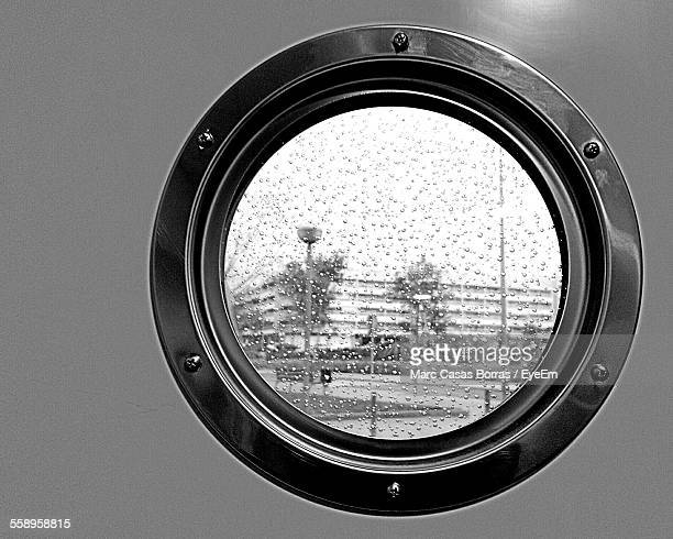 building behind porthole - porthole stock photos and pictures