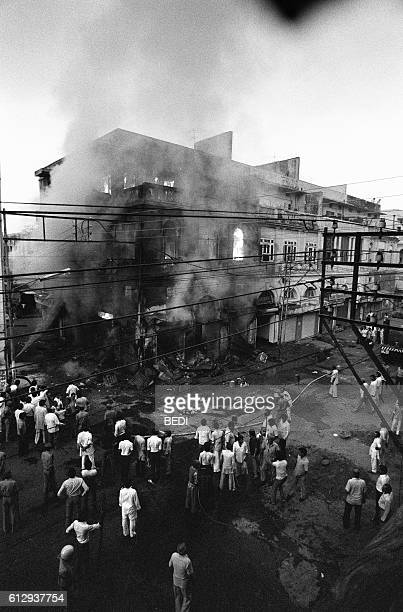 A building belonging to Sikhs burns 02 November 1984 in Daryaganj the old part of New Delhi Violence broke out in India in the wake of Prime Minister...