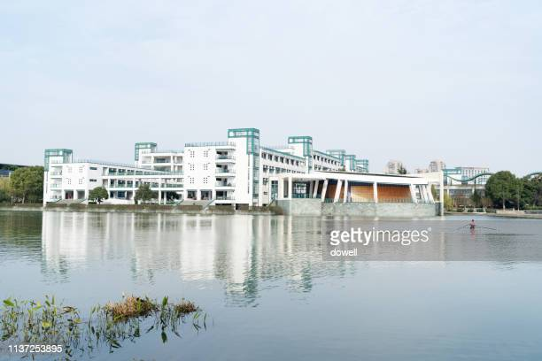 building beside river at zhejiang university - zhejiang province stock pictures, royalty-free photos & images