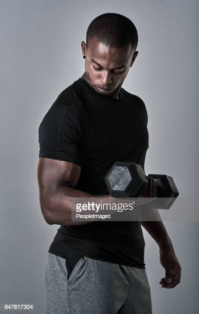 building biceps that bulge - men bulge stock photos and pictures