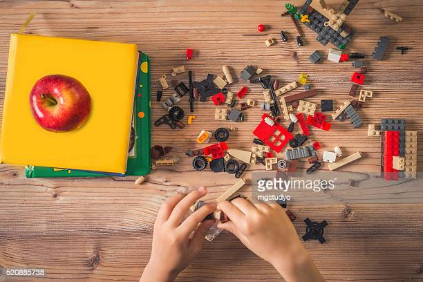 building blocks,lego and book - lego stock pictures, royalty-free photos & images