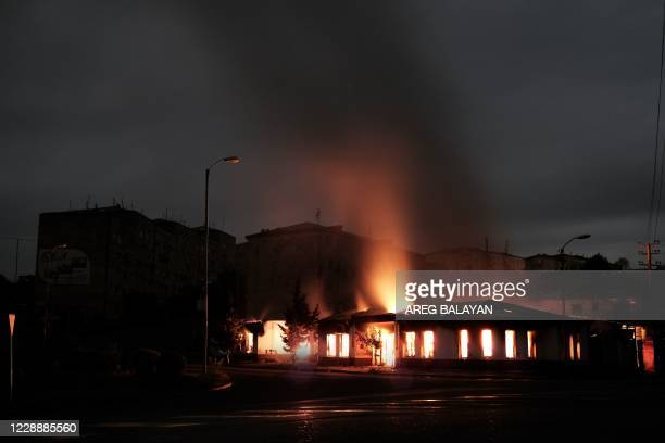 Building burns after recent shelling during the ongoing fighting between Armenia and Azerbaijan over the breakaway Nagorno-Karabakh region, in the...