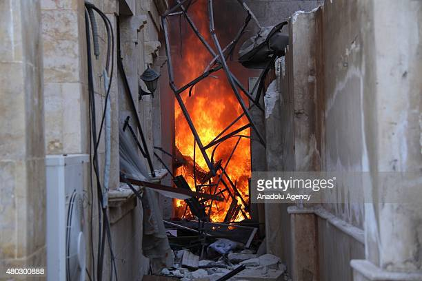 A building burns in flames after forces connected to the Ansar AlSharia operations center attacked buildings containing regime forces in Cemiyetul...