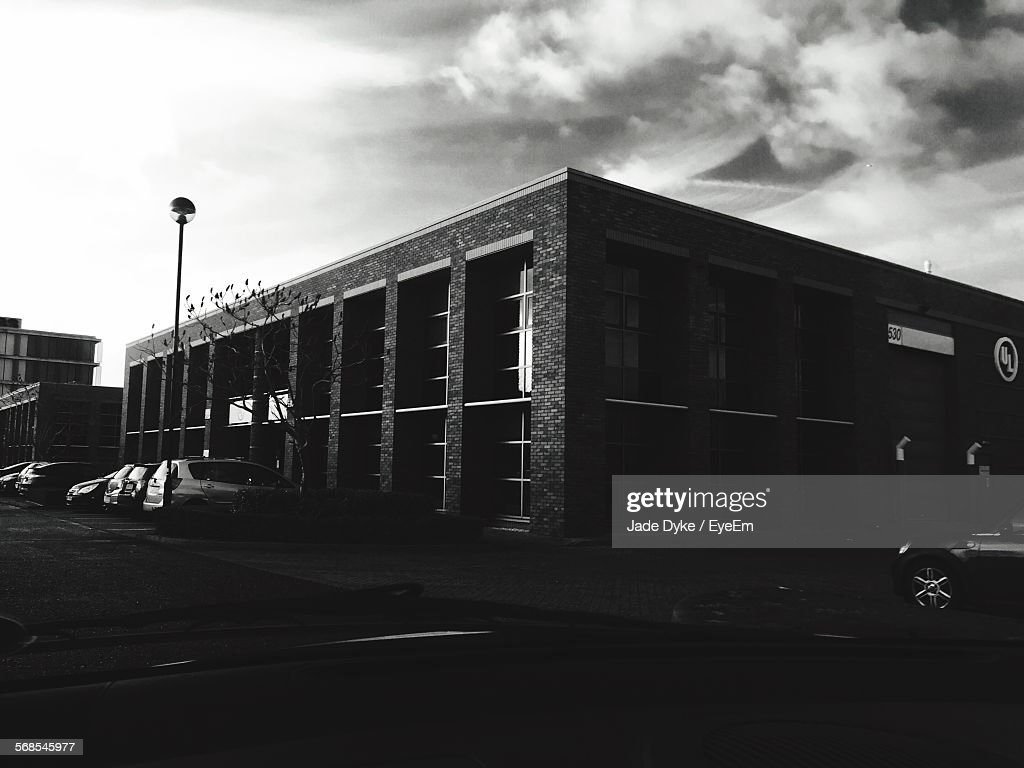 Building By Street Against Sky : Stock Photo