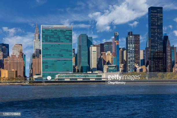 un building, chrysler building and skyscrapers of manhattan east side, new york, usa - united nations building stock pictures, royalty-free photos & images