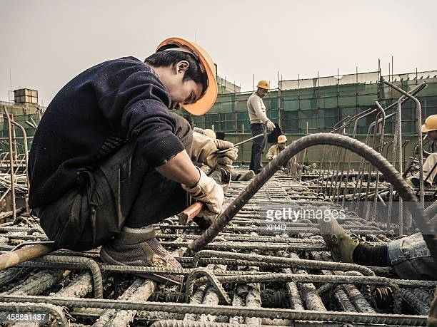 building city - migrant worker stock photos and pictures