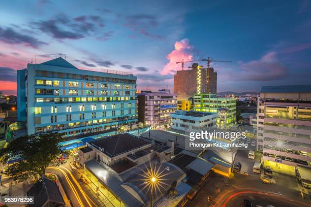 building construction site with big cranes on the top of hospital buildings - hospital building stock photos and pictures