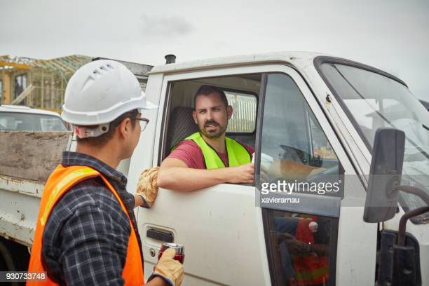 building contractor in truck talking to worker - mid adult men stock pictures, royalty-free photos & images