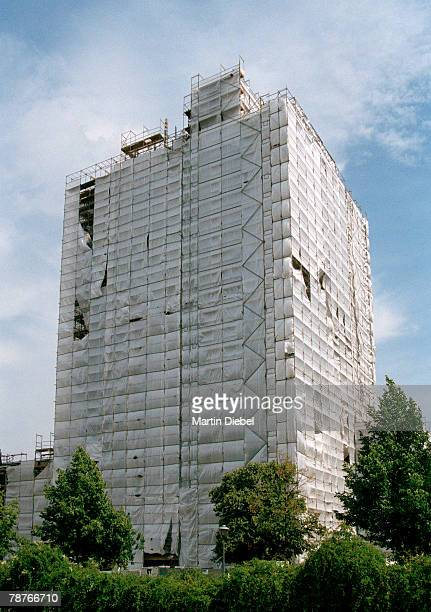 a building covered with tarpaulin - tarpaulin stock pictures, royalty-free photos & images
