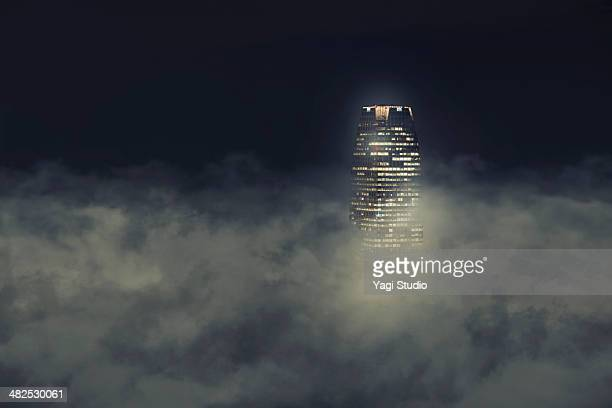 Building covering in clouds