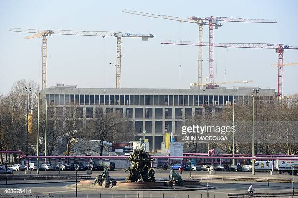 Building cranes are seen at the construction site of the rebuilded 'Berlin Palace' that is to house the cultural project 'Humboldt Forum' on February...