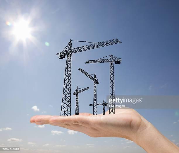 Building cranes in hand