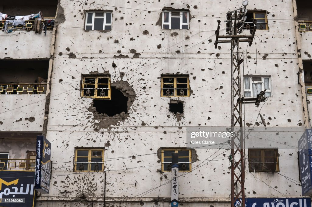 A BUILDING FACADE, SANA'A, YEMEN - 29 APRIL 2017: A building damaged by ground fighting and gunfire during conflict in 2011.
