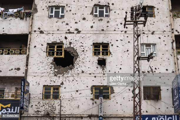A BUILDING FACADE SANA'A YEMEN 29 APRIL 2017 A building damaged by ground fighting and gunfire during conflict in 2011