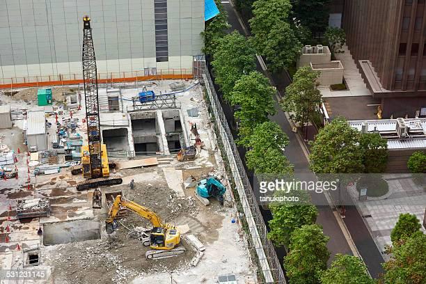 building demolishing in japan - komatsu stock pictures, royalty-free photos & images