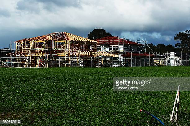 Building development is seen within the new Riverhead housing development on May 19 2016 in Auckland Auckland Funding for new housing and the selling...