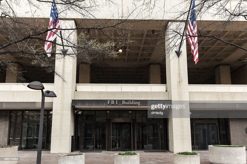 FBI Building Entrance Flanked by Flags : Stock Photo