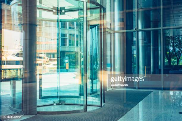 building entrance,revolving door,shanghai - revolve stock photos and pictures
