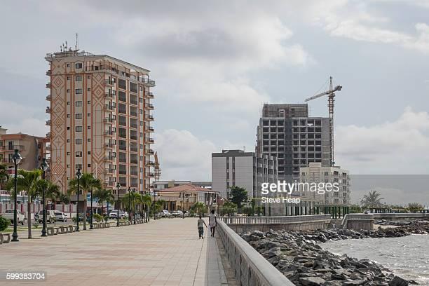 building exterior of large new apartment or hotel buildings on promenade seafront in bata, equatorial guinea - guinea ecuatorial fotografías e imágenes de stock