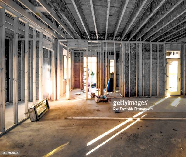 building frame at construction site w/ worker - foundation make up stock pictures, royalty-free photos & images