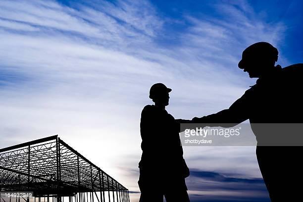 Gebäude Frame Hände schütteln