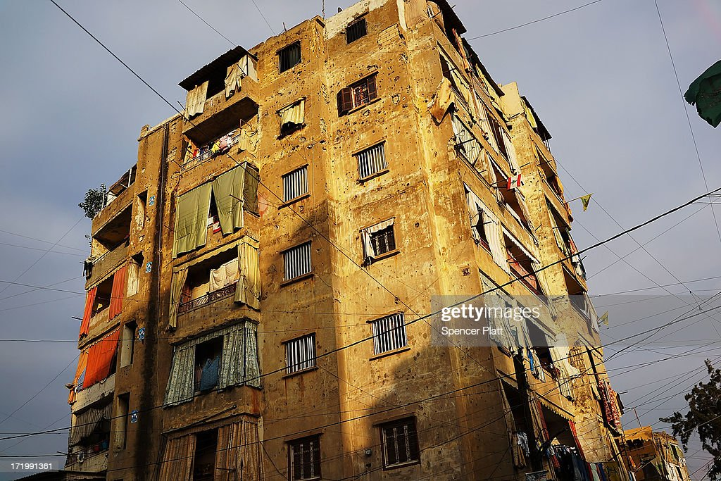 A building housing Syrian refugees is viewed in a poor neighborhood with a high concentration of Syrian refugees on June 30, 2013 in Beirut, Lebanon. Currently the Lebanese government officially hosts 546,000 Syrians with an estimated additional 500,000 who have not registered with the United Nations. Lebanon, a country of only 4 million people, is now home to the largest number of Syrian refugees who have fled the conflict. The situation is beginning to put a huge social and political strains on Lebanon as there is currently no end in sight to the war in Syria.