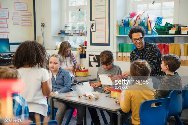 building in elementary class with their teacher - school building stock pictures, royalty-free photos & images