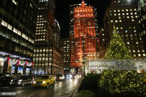 A building is illuminated during the 85th Rockefeller Center Christmas Tree Lighting ceremony at Rockefeller Center in Manhattan borough of New York...