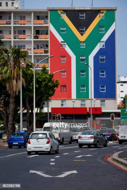 a building is painted with a south african flag mural at the end of long street in cape town, south africa - south african flag stock photos and pictures